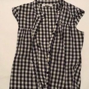 Charlotte Russe black and white checkered vest.